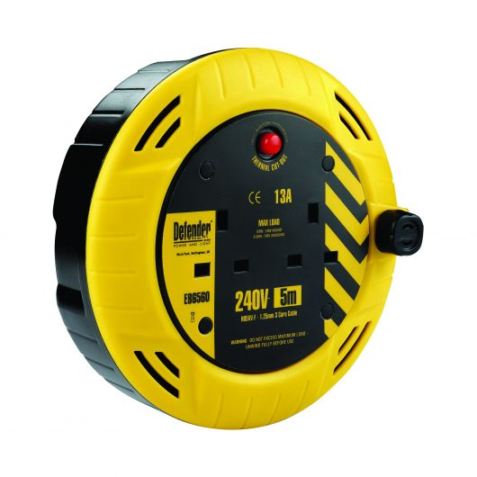 Yellow and black 5M cassette reel with 2 13A power outlets, neon power light and Defender branding, on a white background