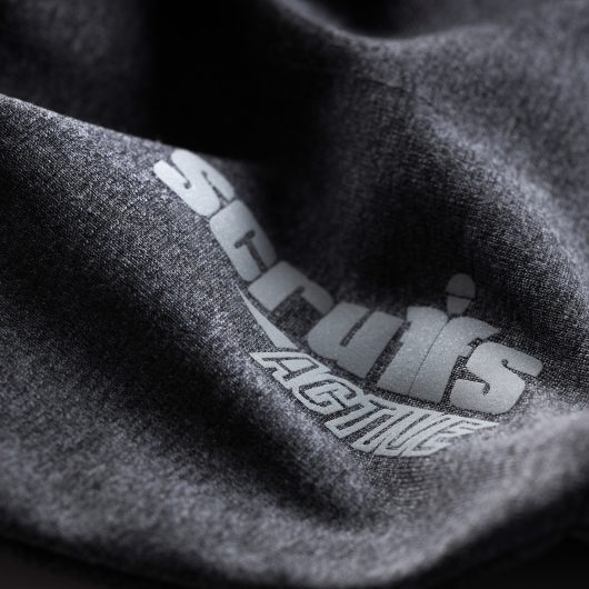 Close up of the contrasting grey Scruffs Active logo on the sleeve of the active hoodie