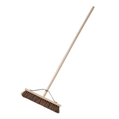 "18"" wooden broom head with hard bassine bristles attached to wooden handle with metal stay on a white background"
