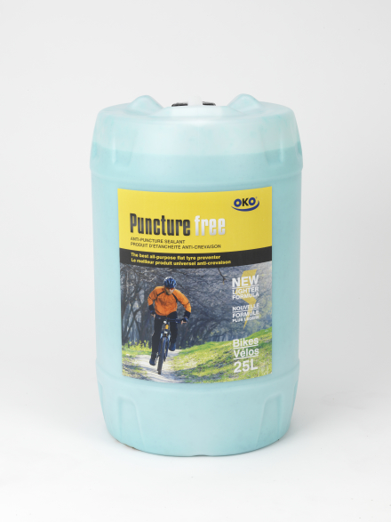 25L drum of OKO puncture free liquid tyre sealant for bicycles with OKO branding and a picture of a cyclist on the label
