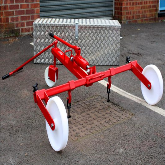 Red steel Mustang hydraulic manhole cover lifter over a manhole cover with Mustang alloy storage box in background