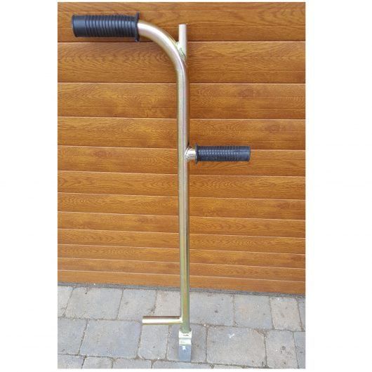 Galvanised metal block paving gap wedge with black rubber handles and hardened wedge against wooden background