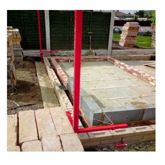 Mustang red steel block builder profiles attached to a wall that's in the process of being built, on a building site