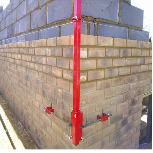 Red steel 6' Mustang external building profile attached to a building in the process of being built