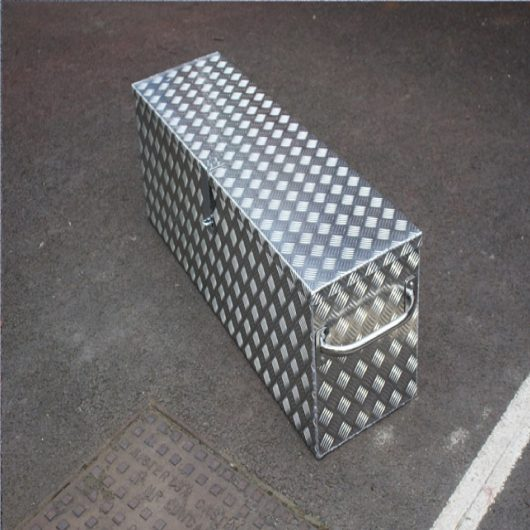 Mustang alloy storage box with handles on the sides and padlock lock, on concrete