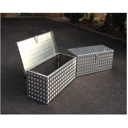 2 aluminum checker plate Mustang storage boxes on concrete, one with its lid open and one with its lid closed