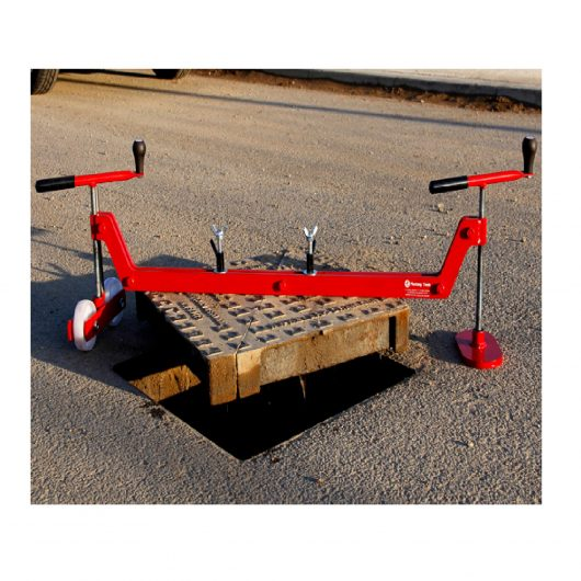 Red steel Mustang chinook manhole cover lifter with white wheels lifting a square manhole cover