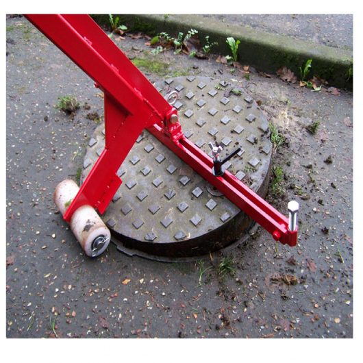 Red steel Mustang pivot lift manhole cover lifter with white wheels lifting a round manhole cover