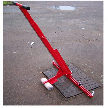 Red steel Mustang pivot lift manhole cover lifter with white wheels lifting a rectangular manhole cover