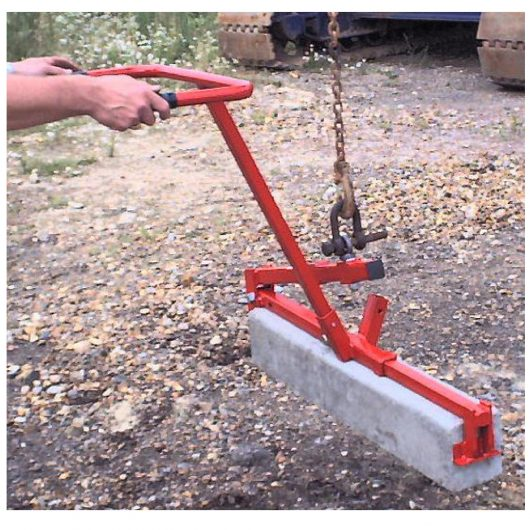 Person using the red steel Mustang mechanical kerb/slab lifter to lift slab