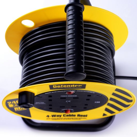 Close up of the 20M black cable around the reel and carry handle on the Defender 4-way cable reel