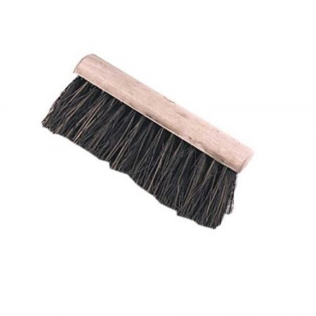 Wooden hard bass yard brush head on a white background