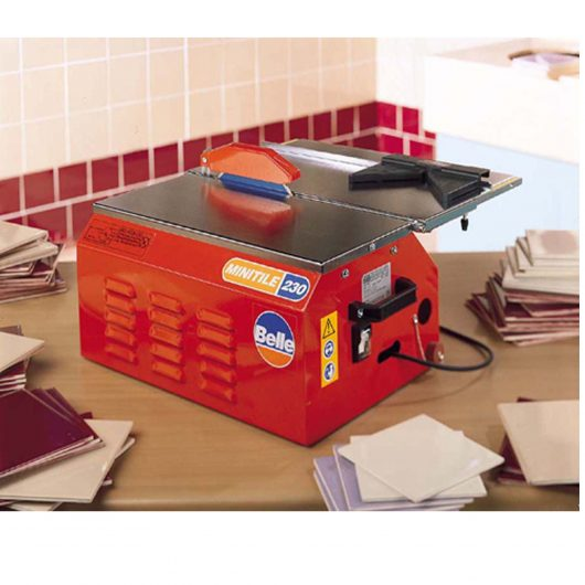 Orange Belle minitile 230 tile saw on work desk surrounded by cut tiles
