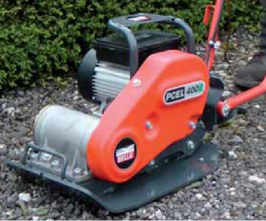 230v Belle PCEL 400E electric wacker plate compactor with protective metal frame and orange Belle branded casing on gravel