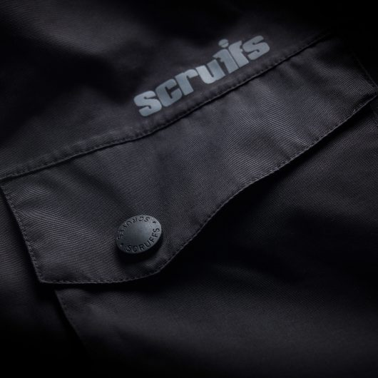 Close up of the Scruffs branded popper closure chest pocket and contrasting grey Scruffs logo on the pro jacket
