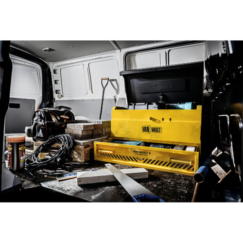 Yellow Van Vault 3 full of work equipment in the back of a work van surrounded by other work equipment/tools
