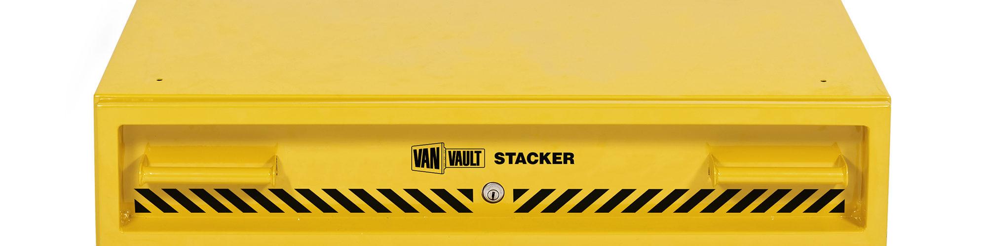 Yellow sheet steel Van Vault stacker drawer with steel grip handles and black Van Vault branding, on a white background