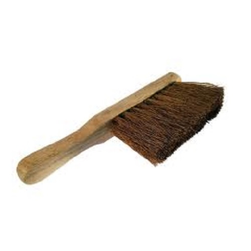 Hand brush with bristles made from soft coco and a wooden handle on a white background