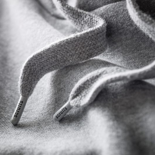 Close up of the grey hood drawcords with Scruffs branded drawcord end toggles on the Scruffs worker hoodie
