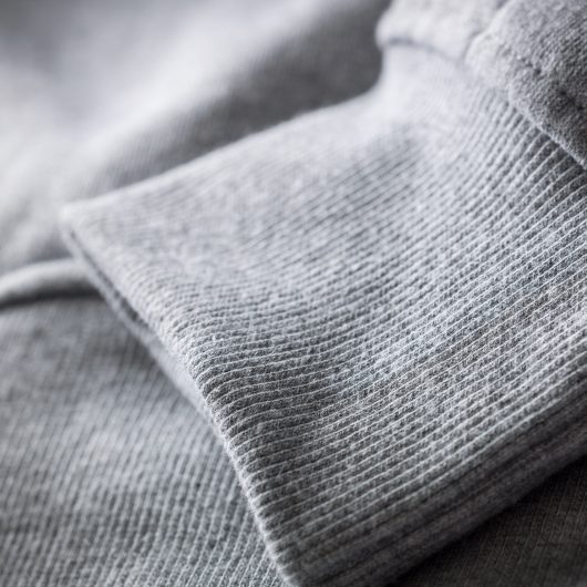 Close up of the grey ribbed cuff on the Scruffs worker hoodie