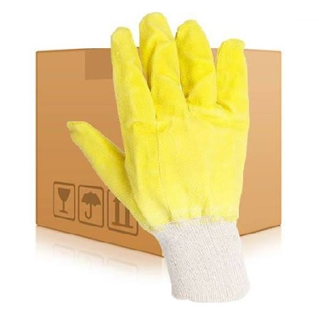 Yellow gripper glove with white ribbed cuff in front of cardboard box