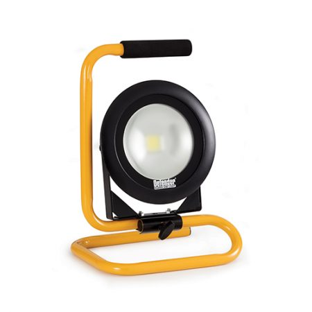 Round Defender DF1200 floorlight with black steel frame mounted onto yellow metal stand