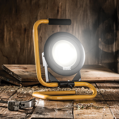 Defender DF1200 floor light turned on next to some cut wood and sawdust