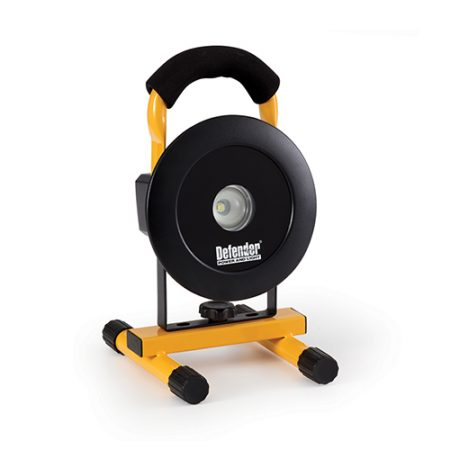 Round Defender LED 400 floorlight with black steel frame mounted onto yellow metal stand