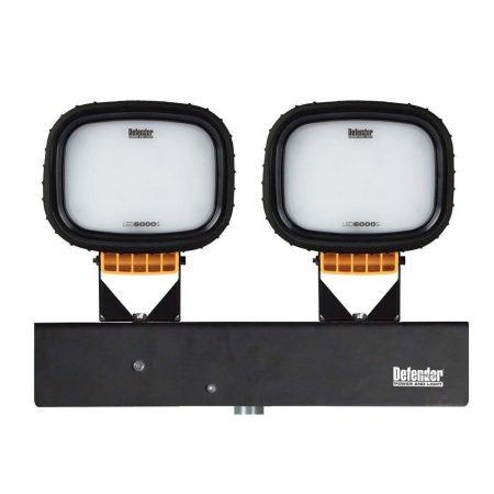 2 Defender floodlight light heads with black silicone sleeves bolted onto black Defender branded metal holder