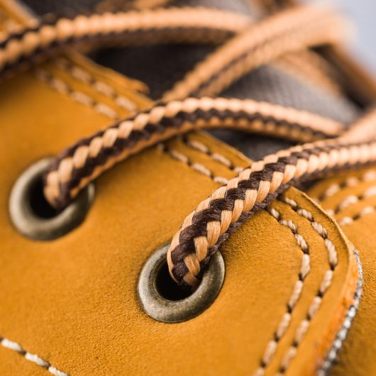Close up of the woven laces and metal lace holes on the Scruffs Sharpe safety boot