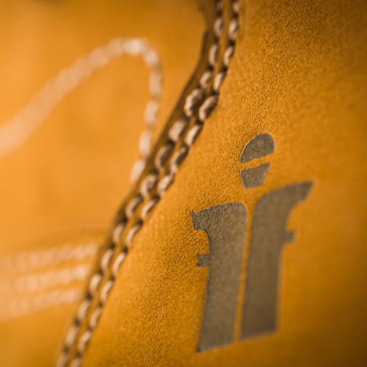 Close up of the small Scruffs logo and stitching on the heel of the Sharpe safety boot