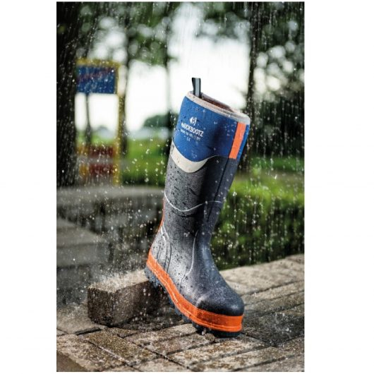Blue Buckler BBZ6000 safety wellington boot standing on bricks out in the rain