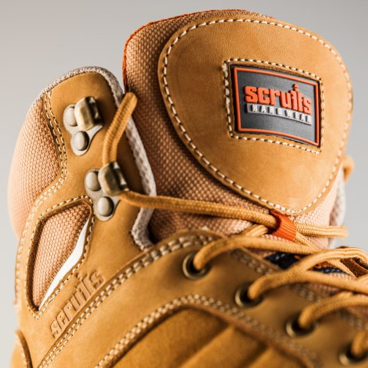 Close up showing the Scruffs logo on the padded textile tongue and the embossed Scruffs logo on the side of the oxide boot