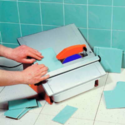 Turquoise bathroom wall tiles being cut by the Belle magik 180 tile saw