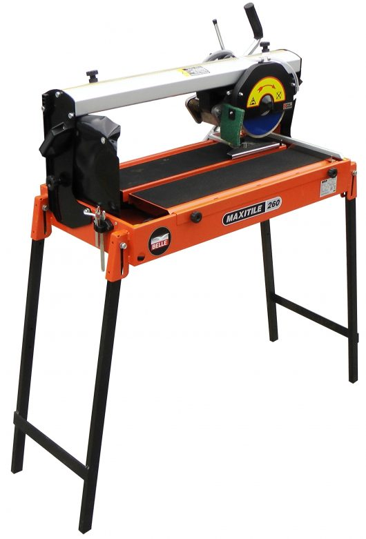 Belle maxitile 260 tile saw on a tall black metal stand with orange metal casing with Belle branding on and a circular blade