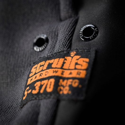 Close up of the orange Scruffs logo and ventilation holes on the trade tech softshell jacket