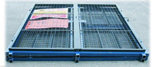 Blue DQGC60 gas cage folded away with safety signs attached laying on concrete floor