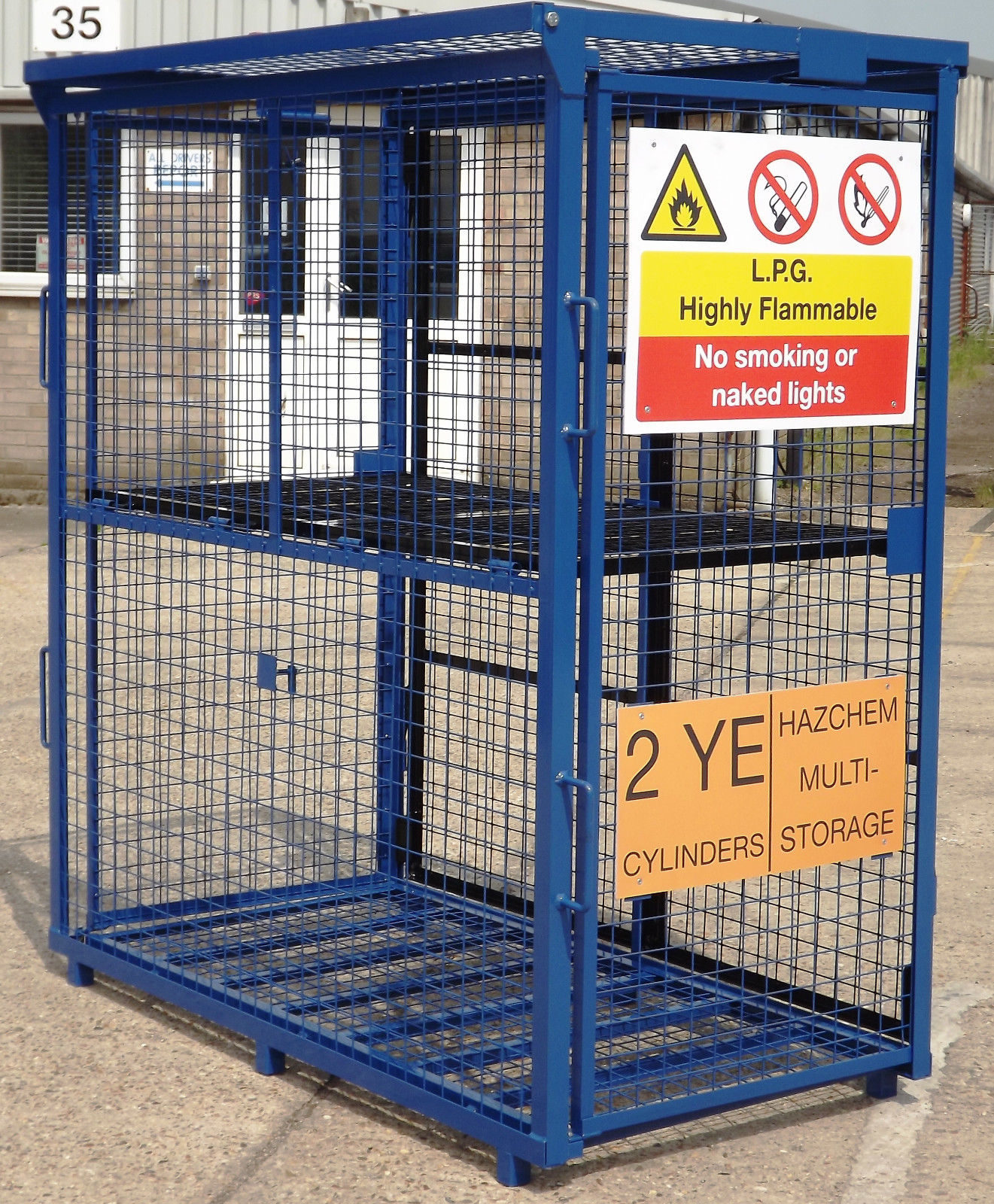 Empty blue DQGC60 gas cage unfolded with safety signs on side