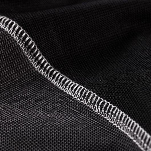 Close up of the contrasting grey stitching at the sleeve of the Scruffs trade active polo in black