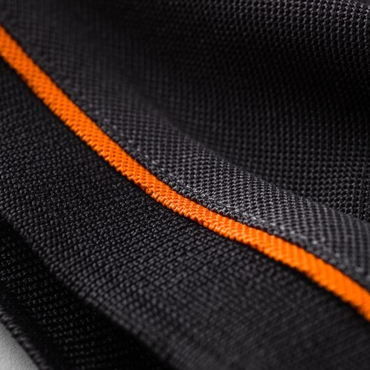 Close up of the graphite coloured sleeve cuff with contrasting orange tipping on the Scruffs trade active polo