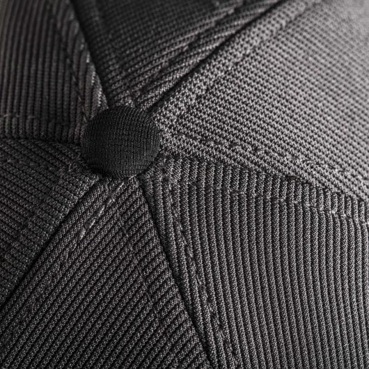 Close up of the top of the Scruffs Work Cap showing the fabric covered button and joining of 6 hat panels