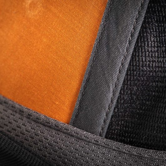Close up of the inside of one of the hat panels showing orange lining