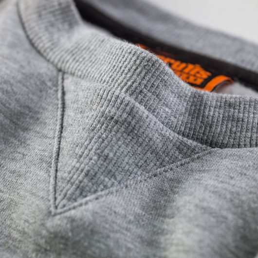 Close up of ribbed triangle neck yoke on the Scruffs trade sweatshirt