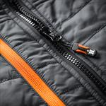 This image shows a close up of the Scruffs Trade Bodywarmer black zip with orange detail