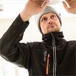 This image shows the Scruffs Trade Flex softshell jacket being worn at work