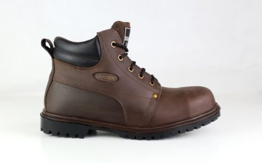 This image shows a side profile of the Samson Crewe Safety boot with steel toe cap and traction controlling diamond cleats